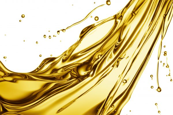 36272372 - engine oil splashing isolated on white background